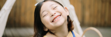 Girl smiling brightly