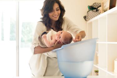 Mother showering a newborn