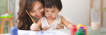mom painting with child