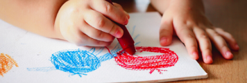 child drawing with crayon