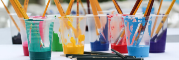 paint and paint brushes of different colours